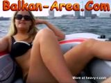 Chubby blonde masturbates on inflatable boat
