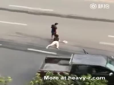 Caveman Drags Woman By Her Hair Across The Street