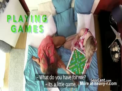 Two girls playing with their pussies