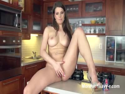 Big titted brunette plays with her pussy in the kitchen