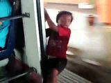 Parents let boy hang out of train