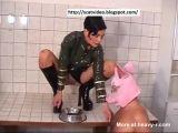 Pig Man Eating Shit