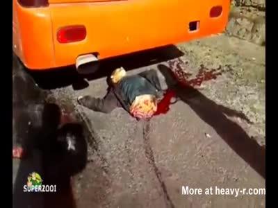 Biker Split In Half By The Wheels Of A Bus